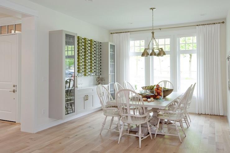Dining Room With Wood Herringbone Wine Rack