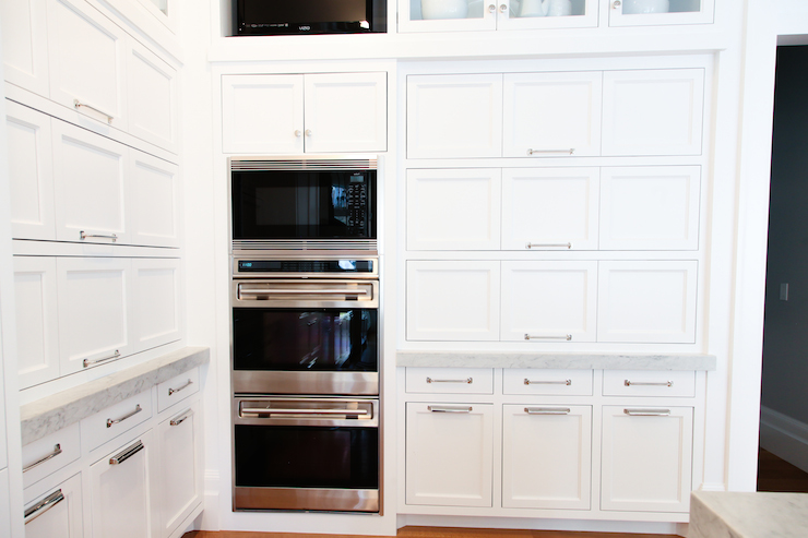 View Full Size. Full Wall Kitchen Cabinets Surround Stainless Steel  Microwave Stacked Over Double Ovens ...