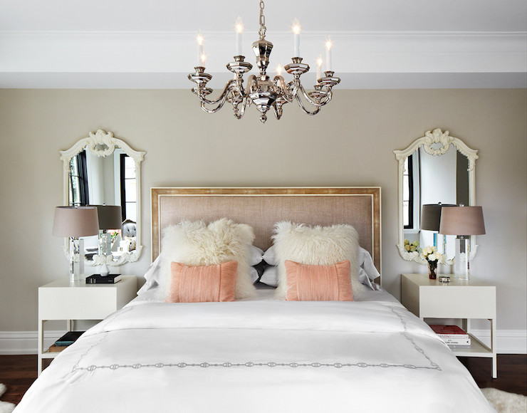 French bedroom features a blush pink headboard dressed in white and pink  bedding  white sheepskin pillows and salmon pink lumbar pillows flanked by  white   Modern French Bedrooms   French   bedroom   The Design Company. French Bedrooms Images. Home Design Ideas