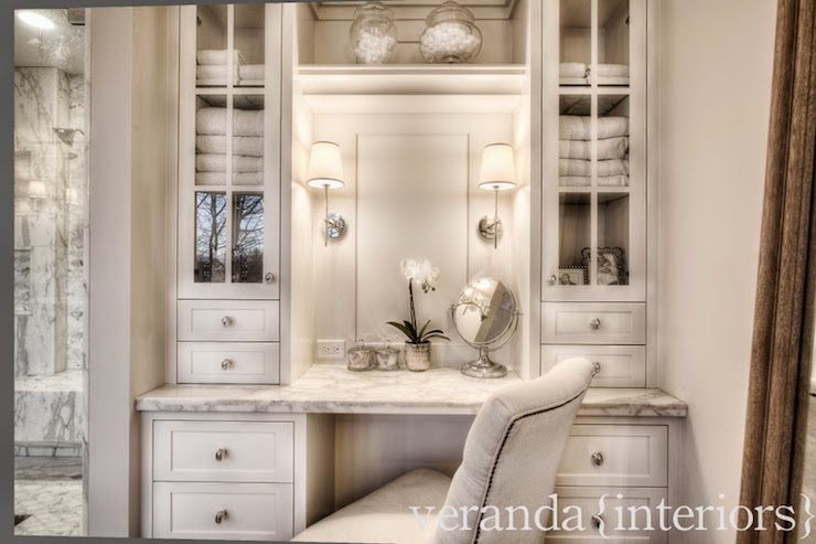 Beautiful Built In White Dressing Table Nook With Nickel Pulls, Gray And  White Marble Countertop And Above Counter, Glass Front Cabinets With Shelf  Over A ...