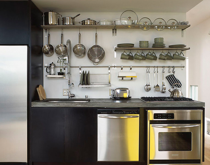 Ikea Kitchen With Stainless Steel Refrigerator Framed By Black Ikea  Cabinets Along With Chunky Gray Counters Accenting An Undermount Stainless  Steel Sink ...