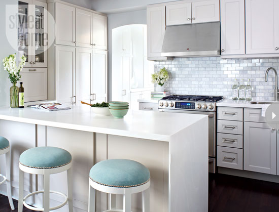 Amazing Kitchen Features Shaker Cabinets Paired With White Corian  Countertops And Bianco Marble Subway Tiled Backsplash.