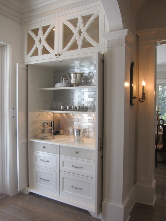 Incredible Hidden Bar Area With Geometric, Glass Front Cabinets Over Slide  Back Doors Which Open To Reveal White Built In Drawers Accented With Nickel  Pulls ...