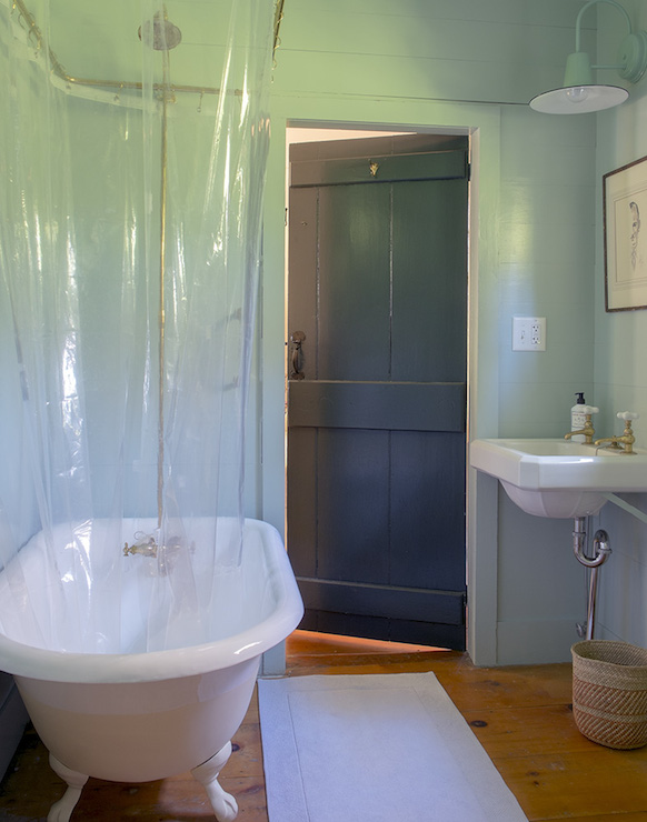 ... Planked Walls Framing White Claw Foot Bathtub Accented With Brass Shower  Rail And Clear, See Through Shower Curtain Across From Wall Mounted Sink  With ...