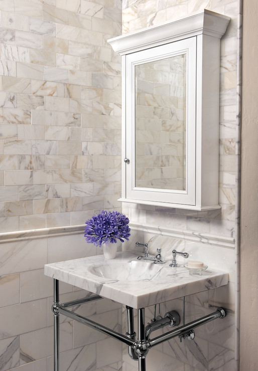 Delightful Quatrefoil Chair Rail Part - 13: Stunning Powder Room With Calcutta Gold Marble Tiled Walls Featuring A  Larger Tiled Lower Wall, Trimmed With Chair Rail Tile Alongside Smaller  Calcutta Gold ...