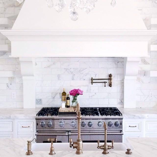 High End White Kitchen: Beveled Marble Subway Tiles