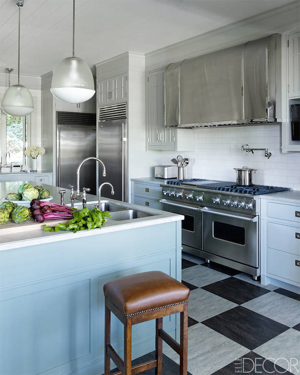 Stunning Kitchen Features White Upper Cabinets And Blue Lower Cabinets