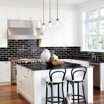 White Kitchen Cabinets With Black Brick Tile Backsplash