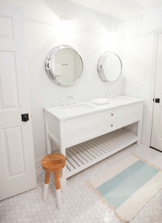 cottage kidsu0027 bathroom features sidebyside porthole mirrors over white double washstand topped with white marble framing his and her sinks and modern