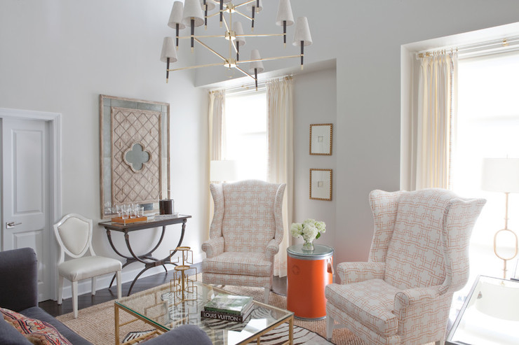 2 tier chandelier design ideas chic living room features jonathan adler ventana three tier chandelier illuminating a pair of wingback chairs upholstered in thom filicia citysquare fabric mozeypictures Images