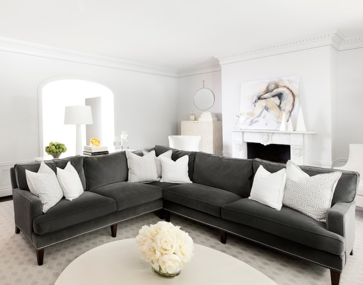 White And Gray Living Room Features Light Gray Paint On Walls Accented With  Dentil Crown Molding Alongside Art On Fireplace Mantle.