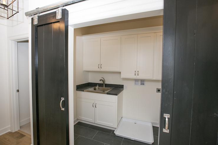 Laundry room barn doors transitional laundry room for Sliding laundry door