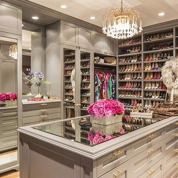 How to store boots traditional closet la closet design for Closet island with glass top