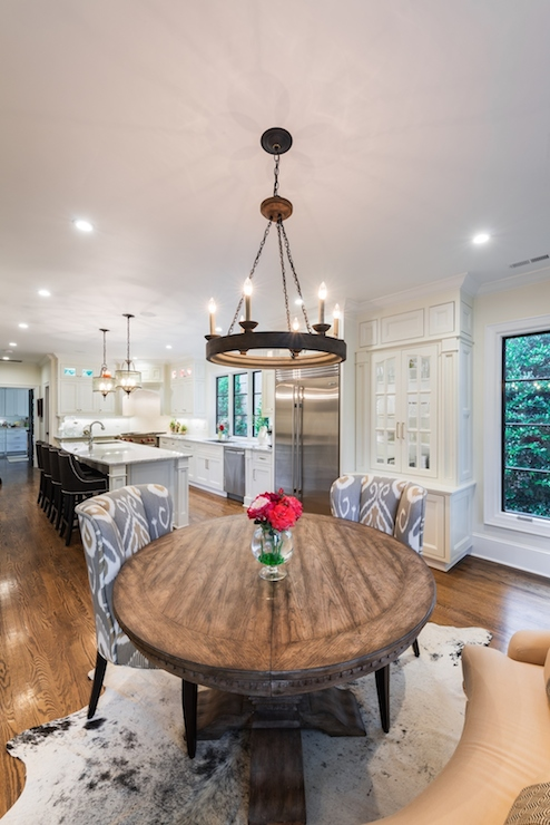 view full size open plan living boasts iron candelabra round salvaged wood dining table