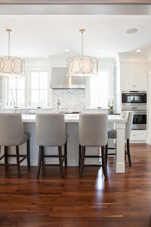 stunning kitchen features shaker cabinets accented with nickel pulls