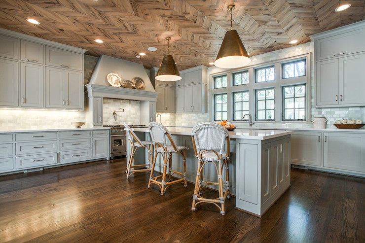 White Pecky Cypress Kitchen Cabinets with Navy Blue Island ...