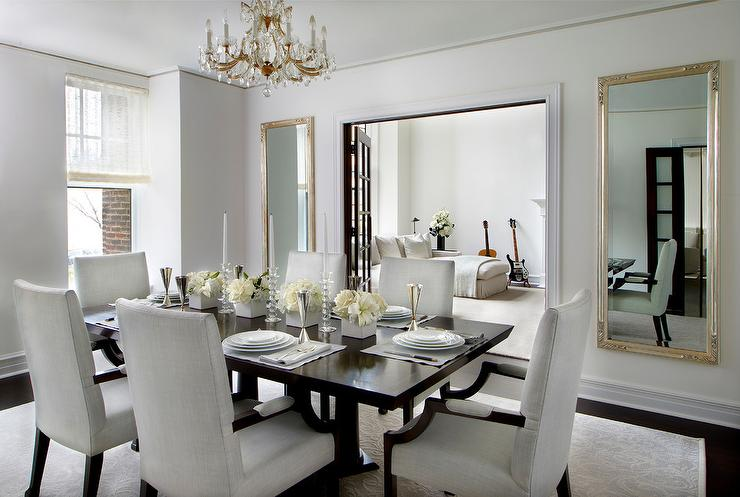 elegant formal dining room with french doors to living room flanked by