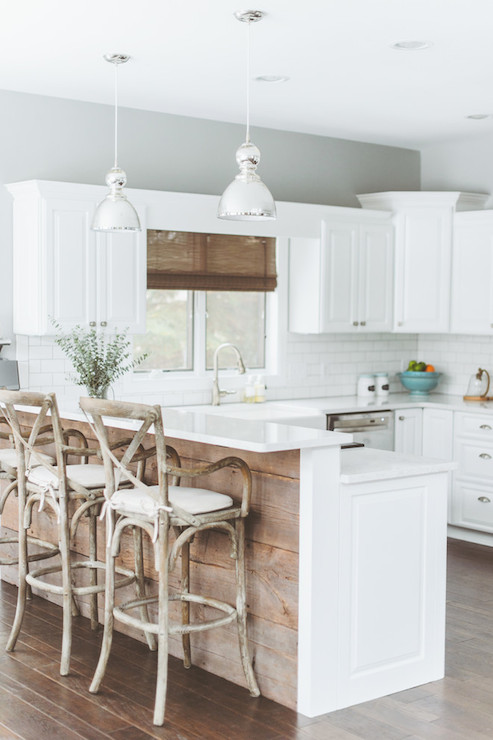 Jamie young st charles clear glass pendant transitional kitchen wood planked peninsula lined with french cafe counter stools tucked below white counters lit by a pair of jamie young st charles mercury glass pendants aloadofball Choice Image