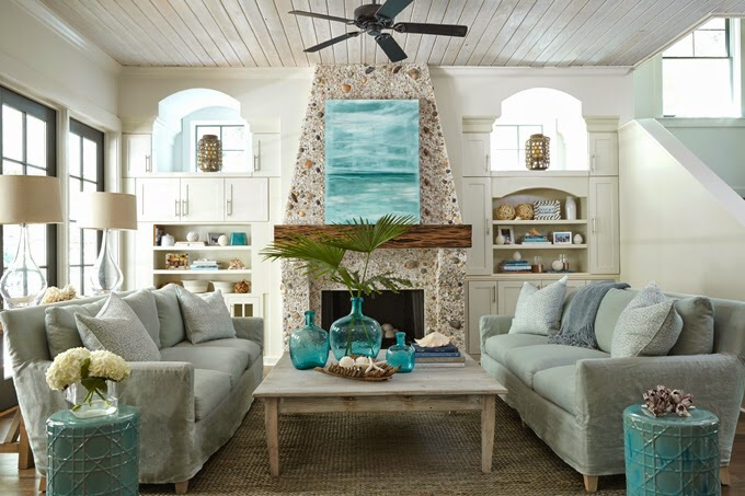 This Beach Cottage Living Room Features A Gorgeous Pebble Stone Fireplace  Adorned With Turquoise Abstract Art Flanked By Built In Bookcases And  Cabinete. Part 52