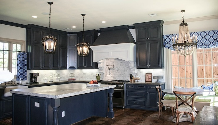 This bold kitchen features navy cabinets with gray perimeter