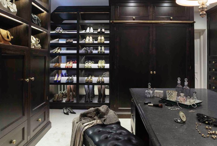 ... With Brass Cabinet Pulls With LED Lighting Illuminating Built In Purse  Cubbies And Tilted Shoe Cubbies Across From A Closet Island Finished With A  Black ...