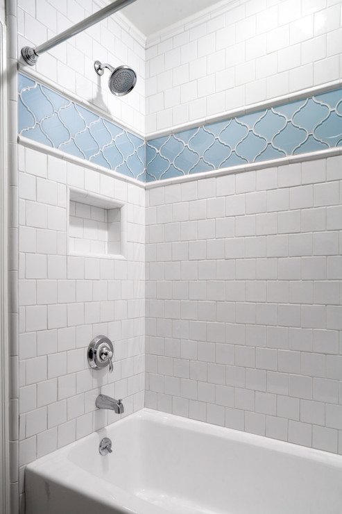 Tub shower combo tiled in white square tiles with a niche below  border of Ann Sacks Lucian Tile Shower Combo Design Ideas