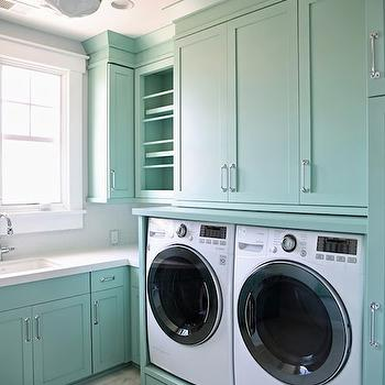 Teal laundry room features Benjamin Moore Wythe Blue cabinets topped ...