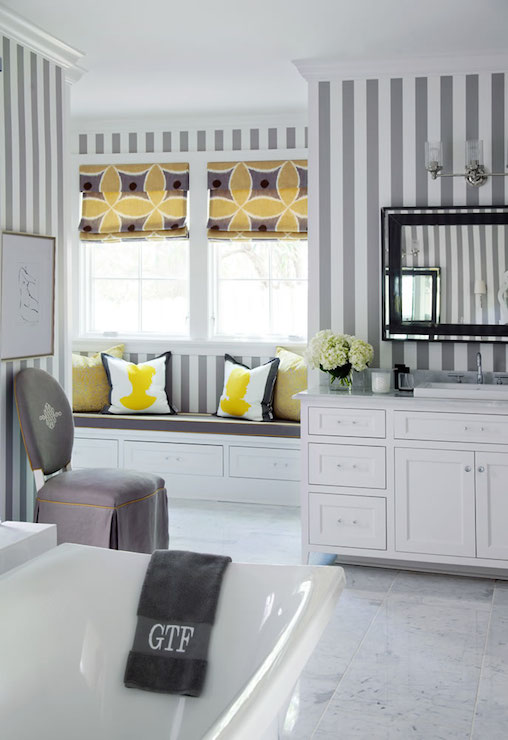 yellow and gray bathroom. Yellow and gray bathroom features white striped wallpaper as a  backdrop to art deco mirror lit by clear glass triple sconce over washstand Bathroom Wallpaper Design Ideas