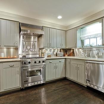 Gray paneled kitchen cabinets cottage kitchen for Brushed aluminum kitchen cabinets