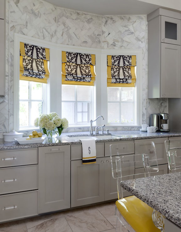 yellow and grey kitchen features center island lined with