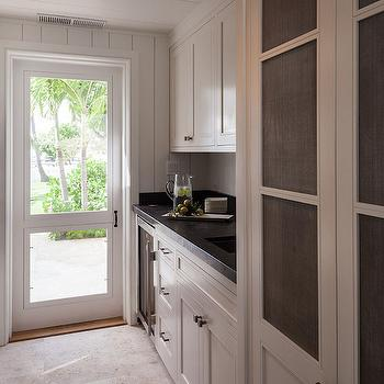 Kitchen With Metal Mesh Cabinet Doors Transitional