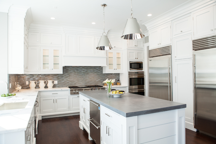 White and gray kitchen features white cabinets paired with white
