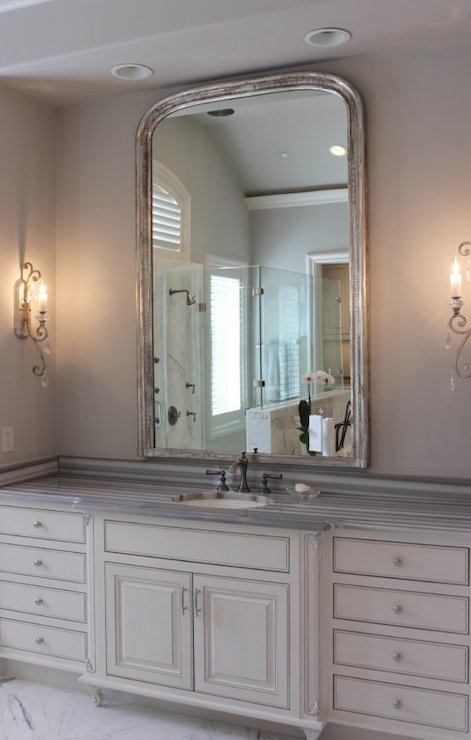 French Inspired Bathroom Features Nook Accented With Pot Lighting Filled  With Antique White Washstand Topped With Striped Gray Marble Countertop  Framing ...