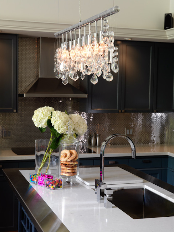 delightful Crystal Kitchen Island Lighting #1: view full size. Contemporary kitchen features Linear Crystal Chandelier  illuminating stainless steel framed island ...