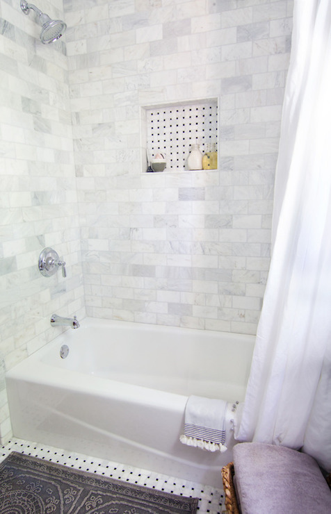 Tub Shower Combo With Polished Venatino Marble Tile Surround Framing A Basketweave Tiled Niche Over Dressed In Simple White Curtain Hung