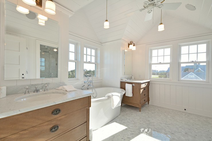 Cottage Bathroom Boasts Vaulted Paneled Ceilings Accented With Fan And Mini Pendant  Lights Over Oval Freestanding Bathtub Placed Under Window Flanked ... Part 82