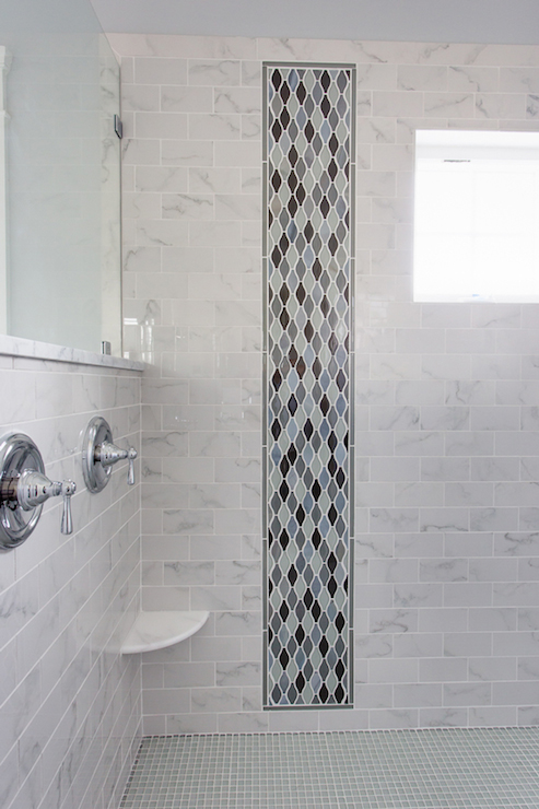 Oversize Walk In Shower With Marble Subway Tiled Surround Accented A Slim Vertical Panel Of Blue And Gray Arabesque Tile Corner Ledge To