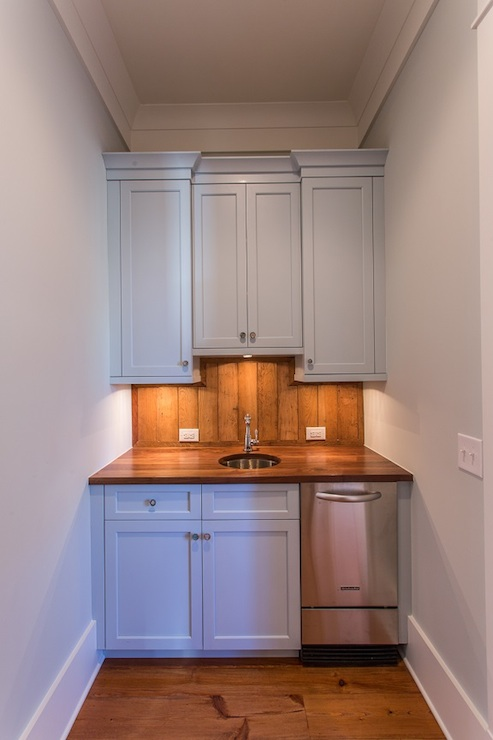 Cottage Wet Bar With Blue Cabinets And Blue Floating Shelves Cottage Kitchen