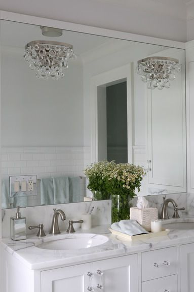 Bathroom Sconces With Bling white washstand with black mirror - transitional - bathroom