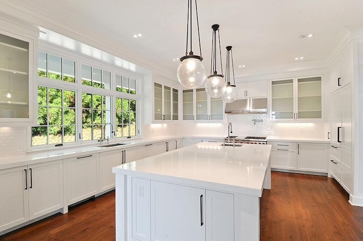 Stunning White Kitchen Features Rejuvenation Classic Globe Pendants Over  Long Center Island Topped With White Quartz Framing Square Prep Sink  Accented With ...