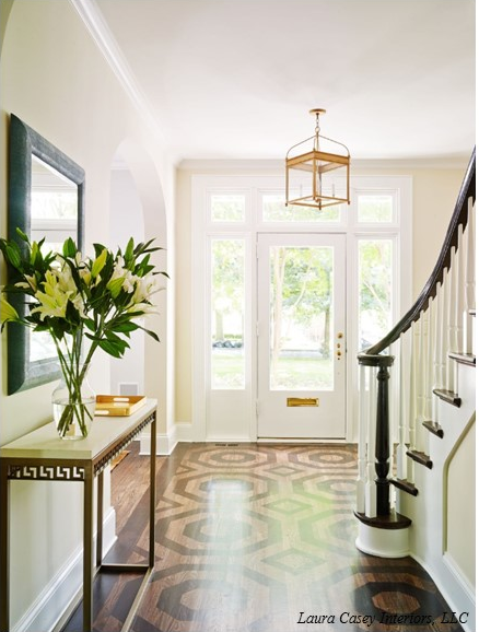 Incredible Entryway With Transom Window And Sidelights Framing A Glass Front  Door Accented With Brass Trim Illuminated By A Brass Arch Top Lantern  Pendant.