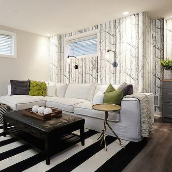 Fantastic basement family room boasts Cole & Son Woods Wallpaper on ...