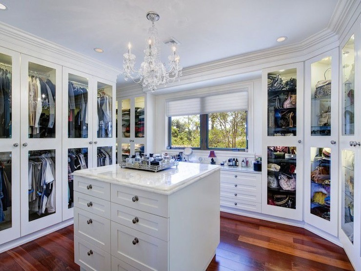 Stunning Walk In Closet With Wraparound Glass Front Closets On Either Side Of The Window Built Dresser Drawers Below Across From Island