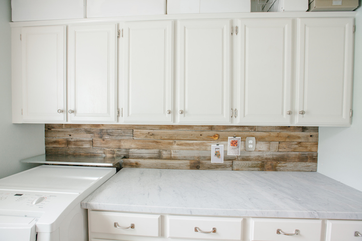 wood planked backsplash adorned with a stainless steel ledge over the