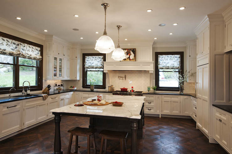 U Shapped Kitchen With White Cabinets Wood Flooring on