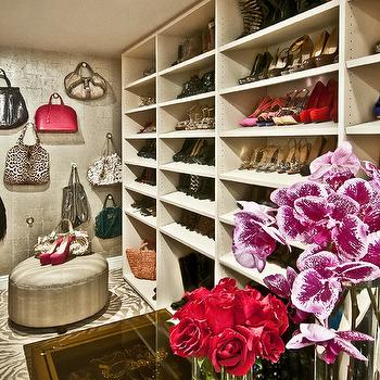 Glam Closet With Black Curved Leaning Mirror And Gold And