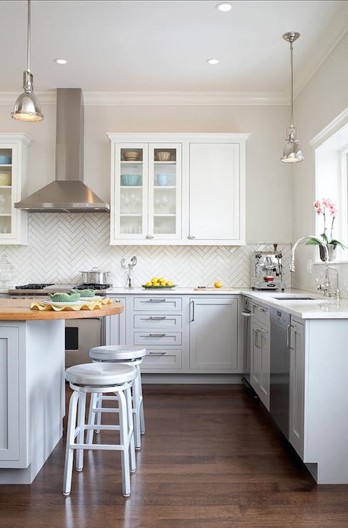gray kitchen peninsula with butcher block countertop