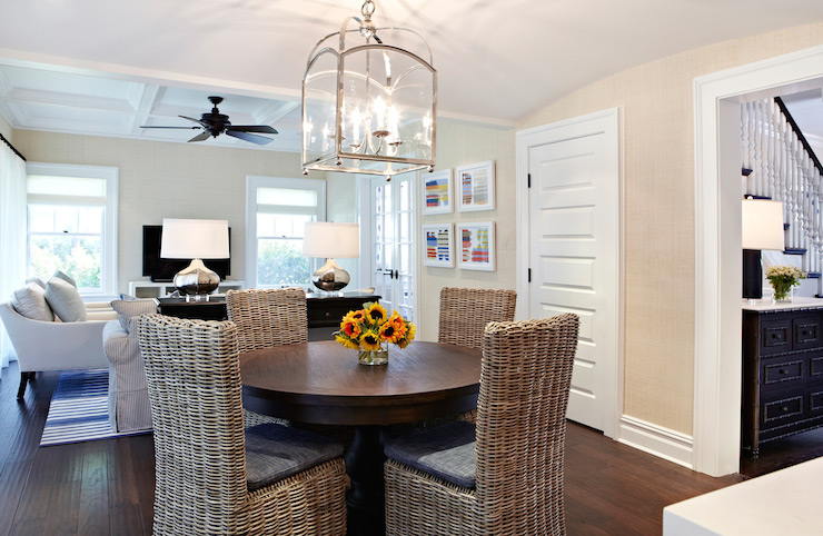 Open Floor Plan Living Features A Small Arch Top Lantern Illuminating Pedestal Dining Table Surrounded By Wicker Chairs Placed In Front Of Espresso