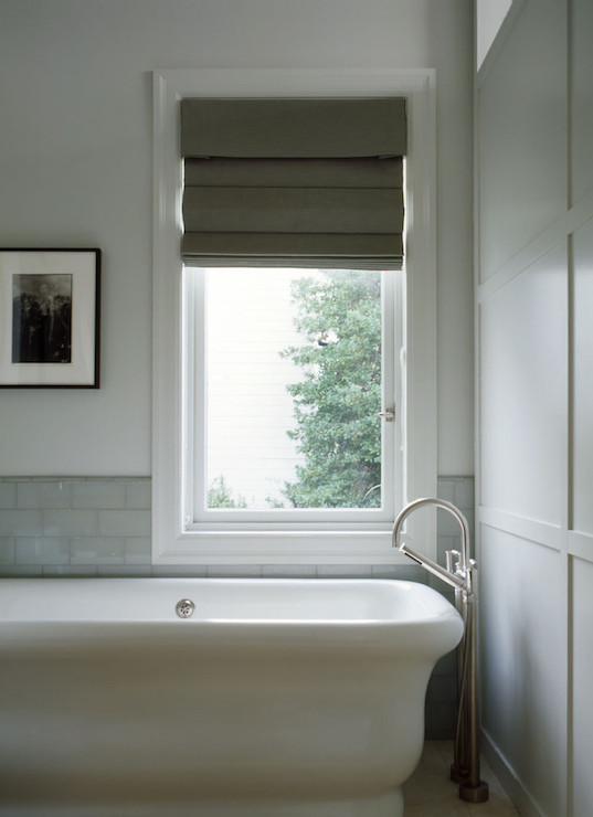 Marble Tiled Tub Under Window Dressed With Gray Geometric
