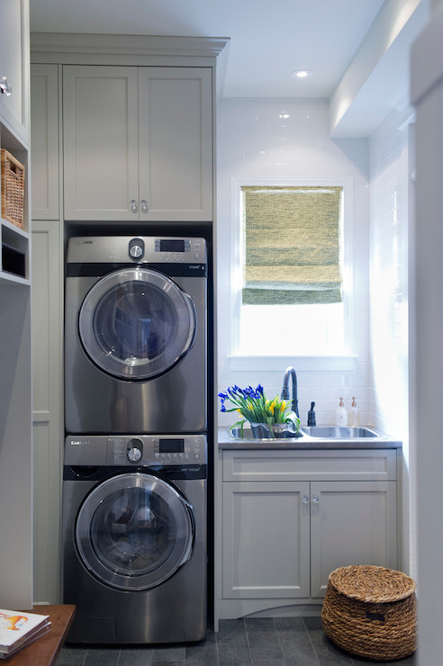 Stacked washer and dryer transitional laundry room for Utility room design